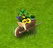 taczka pełna kwiatów.png